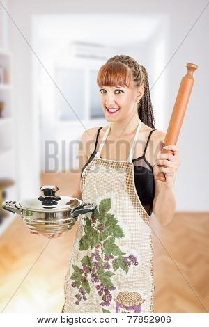 Beautiful Young Woman In Apron Holding Pot And Rolling Pin