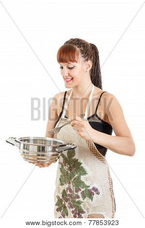 Proud Cook With Pot In The Kitchen Wearing Apron