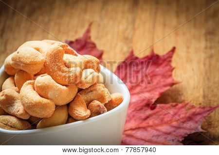 Cashew Nuts In Bowl On Wooden Background