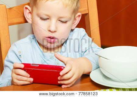 Boy Drooling Eating Breakfast Playing With Mobile Phone