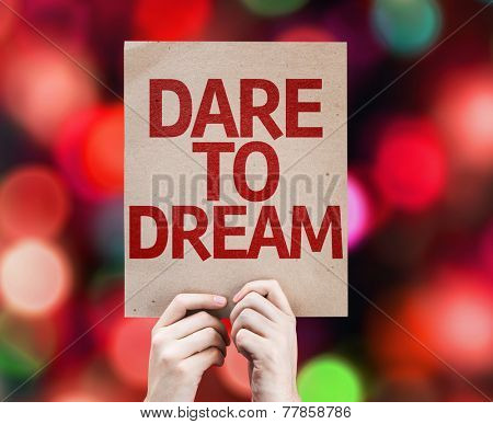 Dare To Dream card with colorful background with defocused lights