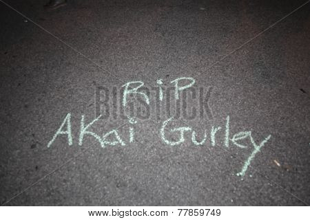 RIP Akai Gurley in chalk on cement