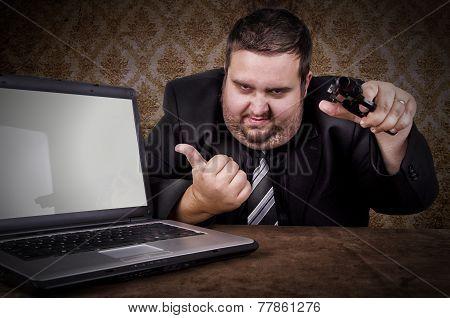 Businessman Pointing Gun At Camera.