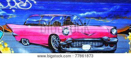 Street art Montreal pink Cadillac