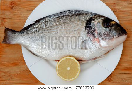 Beautiful bream on a dish with wooden background