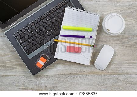 Work Items On Wooden Desktop