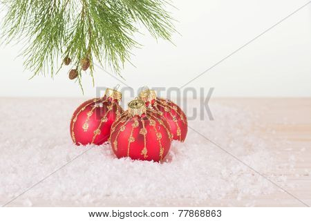 Red Christmas Baubles And Pine Tree Branch