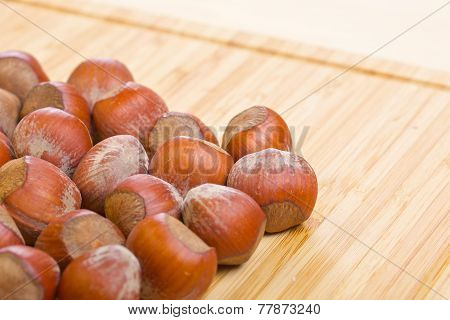 Hazelnuts, filbert on old wooden background. Empty space
