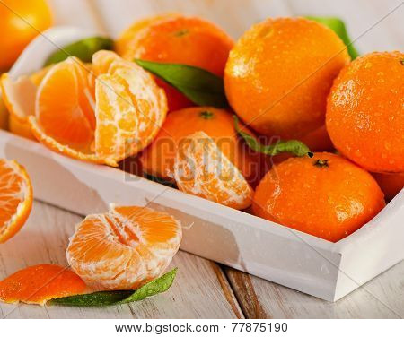 Fresh Mandarines  On A Wooden Background.