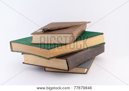 Pile Of Old Books With Pen On Them