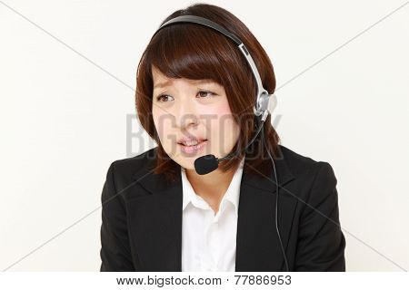 businesswomanof call center perplexed to a complaint telephone