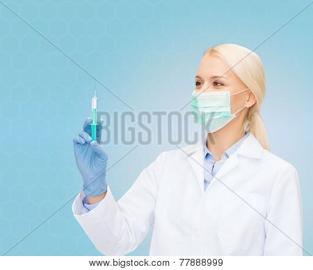 healthcare and medicine concept - female doctor in mask and gloves holding syringe with injection over blue background
