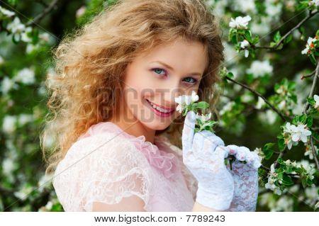 Smiley Model Posing In White Flowers