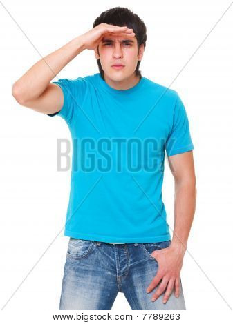 Handsome Man In Blue T-shirt Is Scrutinizing