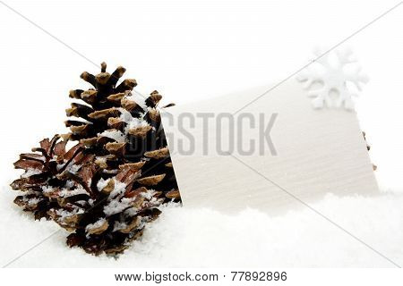 White Christmas Decoration With Wishes Card On Snow