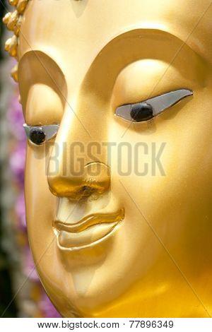 Golden Buddhist Statue Face