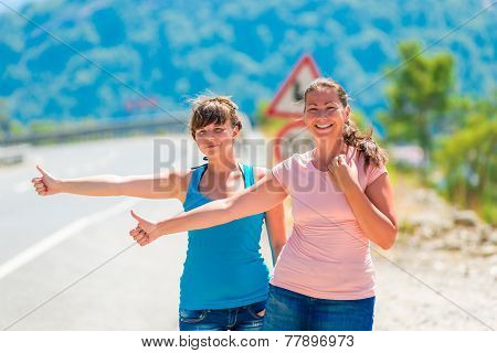 Beautiful Young Girlfriends Stopped Passing Car