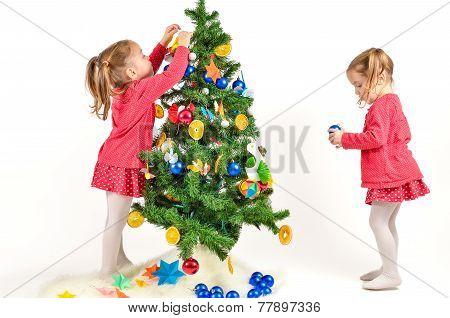 Children Are Decorating Christmas Tree