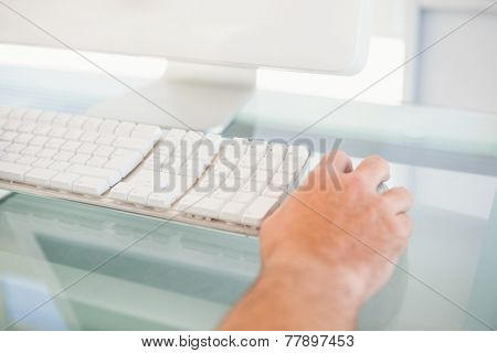 Close up of a man using mouse in his office