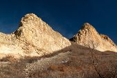 stock photo of dike  - Bright afternoon sunlight turns the stepped formation of the Devil - JPG