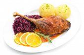 pic of canard  - Crusty goose leg with braised red cabbage and dumplings isolated on white - JPG