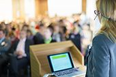 picture of speaker  - Female speaker at Business Conference and Presentation - JPG