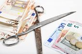 stock photo of poverty  - the scissors between poverty and wealth goes further apart illustrated with euros - JPG