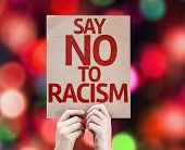 picture of racial discrimination  - Say No To Racism card with colorful background with defocused lights - JPG