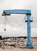 picture of loading dock  - Huge cranes to load boats in a small fishing port - JPG