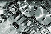 pic of titanium  - cogwheels and gears against titanium - JPG