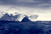 picture of iceberg  - Antarctic iceberg in the snow - JPG
