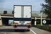 picture of semi trailer  - a truck on a dutch highway with blue sky - JPG
