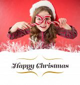 image of candy cane border  - Happy little girl in santa hat holding candy canes against border - JPG
