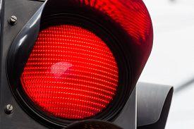stock photo of traffic signal  - a traffic light shows red light - JPG