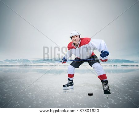 Male hockey player on ice smiling into camera