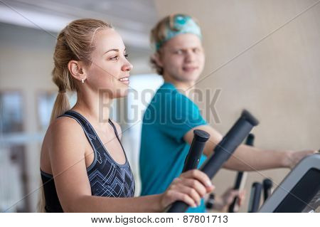 Young People On Run Simulators In Gym