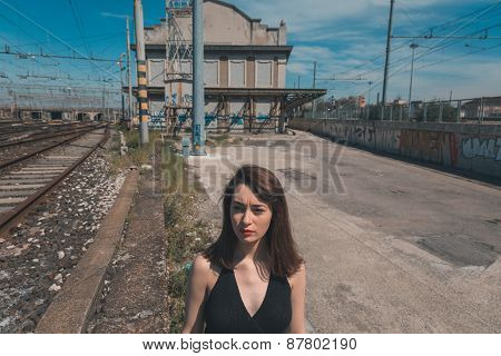 Beautiful Brunette Posing In An Industrial Context