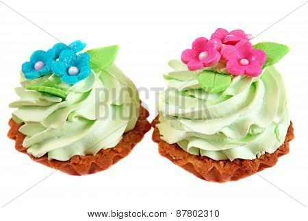 Cake Basket Decorated With Light Green Cream And Pink Flowers From Mastic