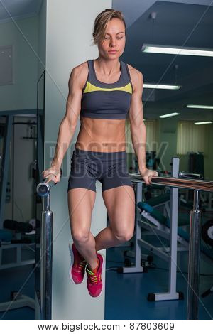 Women's sports. Strong girl in the gym. Girl doing exercises