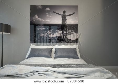 Man at the Sea Artwork Hanging on a Gray Wall Inside an Architectural Bedroom with White and Gray Bed. 3d Rendering.
