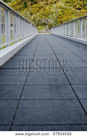 Low Angle Perspective Of Empty Foot Bridge - Vertical.
