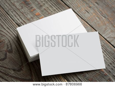 Business cards on wood table ( with separate layer clipping path : Card upper,Card lower )