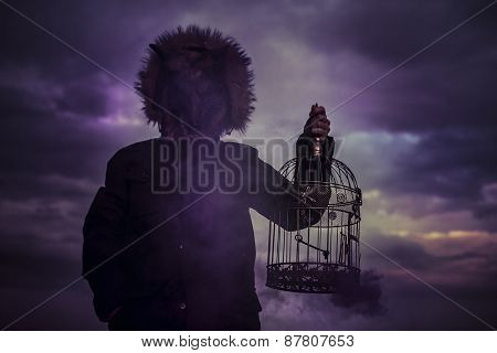 man with mask wolf cage at sunset, dreams and nightmares