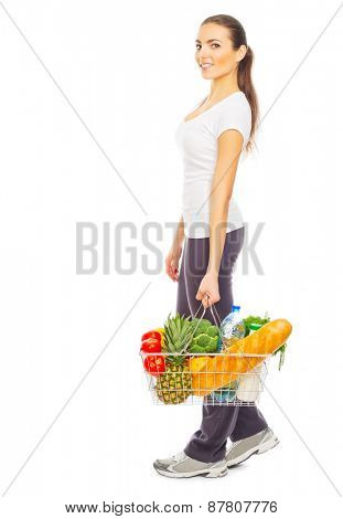 Young girl with full food basket isolated