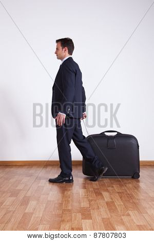 Businessman pulling his luggage
