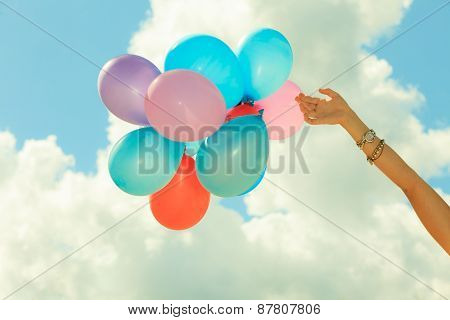 Hand Holding Balloons Sky Background