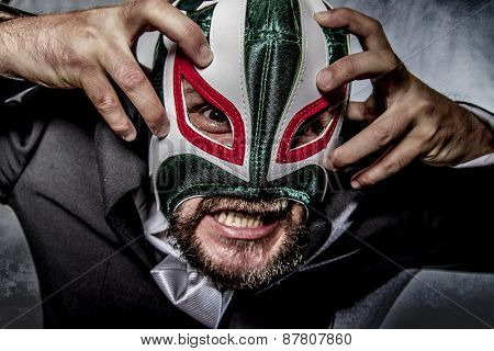 Shouting, angry businessman  with Mexican wrestler mask