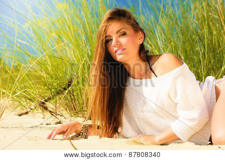 Young Woman Posing On Grassy Dune
