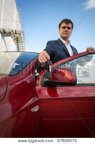 Happy Young Businessman Showing New Car Keys