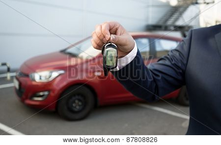 Closeup Shot Of Man In Suit Showing Car Keys With Remote Control